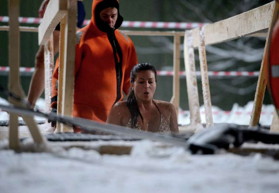 MOSCOW, RUSSIA - JANUARY 18: Orthodox Christians dive into the water to sanctify themselves at the night of Epiphany, at -17 Celcius. Christians believe that Jesus was baptized at that night. (Photo by Sefa Karacan/Anadolu Agency/Getty Imsges) Photo: Anadolu Agency, Getty Images / 2014 Anadolu Agency