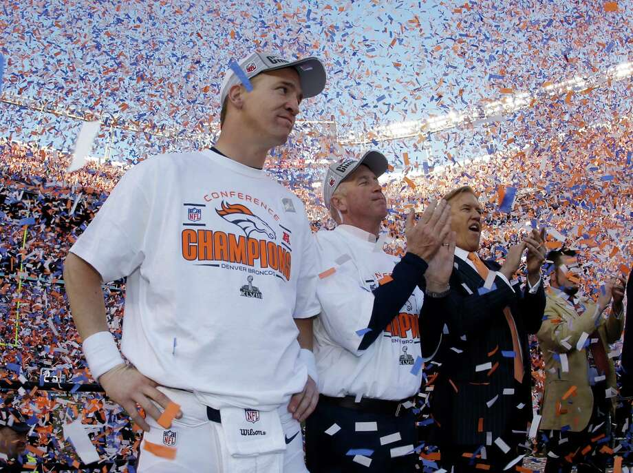 Denver Broncos quarterback Peyton Manning, stands with Broncos' head coach  John Fox and Broncos VP John Elway during the trophy ceremony after the AFC Championship NFL playoff football game in Denver, Sunday, Jan. 19, 2014. The Broncos defeated the Patriots 26-16 to advance to the Super Bowl. (AP Photo/Charlie Riedel) Photo: Charlie Riedel, Associated Press / AP