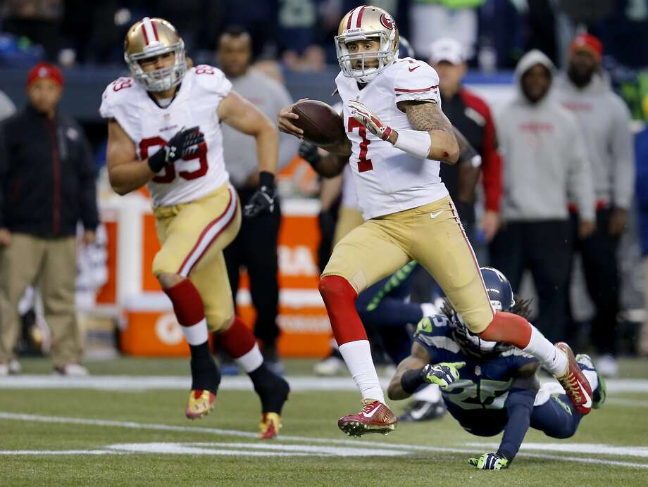 Colin Kaepernick ran for a first down in the first half. The San Francisco 49ers meet the Seattle Seahawks for the NFC title at CenturyLink field in Seattle, Washington Sunday January 19, 2014. Photo: Brant Ward, The Chronicle
