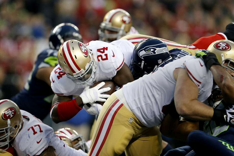 Anthony Dixon (24) goes in for the 49ers first touchdown in the first half. The San Francisco 49ers meet the Seattle Seahawks for the NFC title at CenturyLink field in Seattle, Washington Sunday January 19, 2014. Photo: Brant Ward, The Chronicle