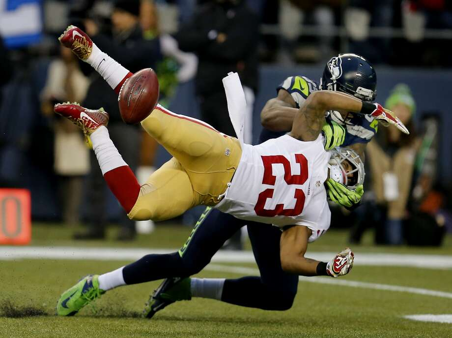 Seattles Ricardo Lockette (83) forced LaMichael James to lose the ball on a punt in the first half. The San Francisco 49ers meet the Seattle Seahawks for the NFC title at CenturyLink field in Seattle, Washington Sunday January 19, 2014. Photo: Brant Ward, The Chronicle