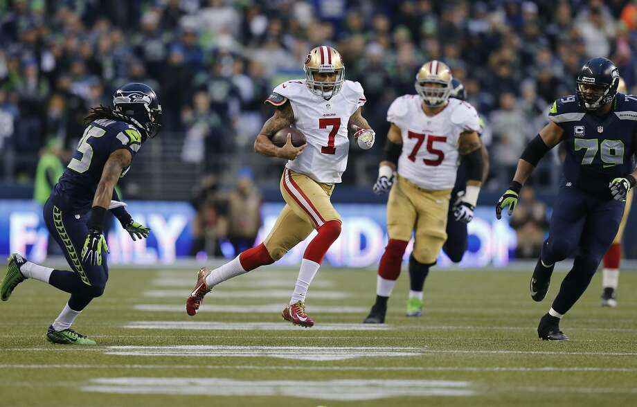49ers quarterback Colin Kaepernick, (7) on a 58 yard run in the second quarter, as the San Francisco 49ers take on the Seattle Seahawks in the NFC Championship game at CenturyLink Field in Seattle, Washington on Sunday Jan. 19,  2014. Photo: Michael Macor, The Chronicle