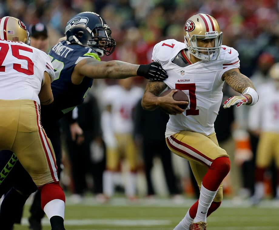 Colin Kaepernick (7) took off for a run in the first quarter. The San Francisco 49ers meet the Seattle Seahawks for the NFC title at CenturyLink field in Seattle, Washington Sunday January 19, 2014. Photo: Brant Ward, The Chronicle