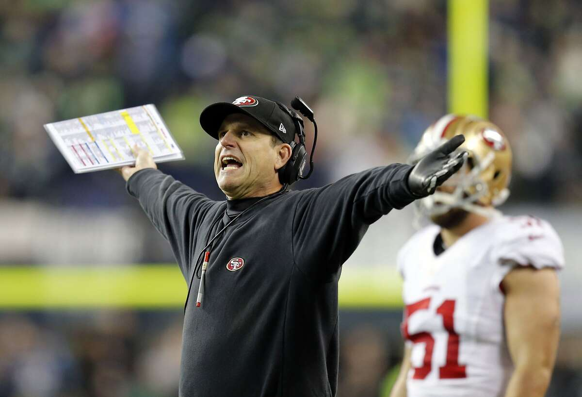 49ers head coach Jim Harbaugh reacts to a penalty call in the second quarter, as the San Francisco 49ers take on the Seattle Seahawks in the NFC Championship game at CenturyLink Field in Seattle, Washington on Sunday Jan. 19, 2014.