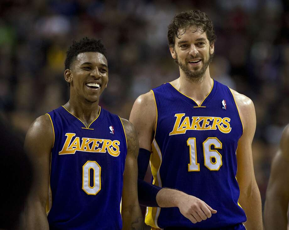 Nick Young (left) and Pau Gasol are smiling again now that the Lakers are back to winning. Photo: Frank Gunn, Associated Press