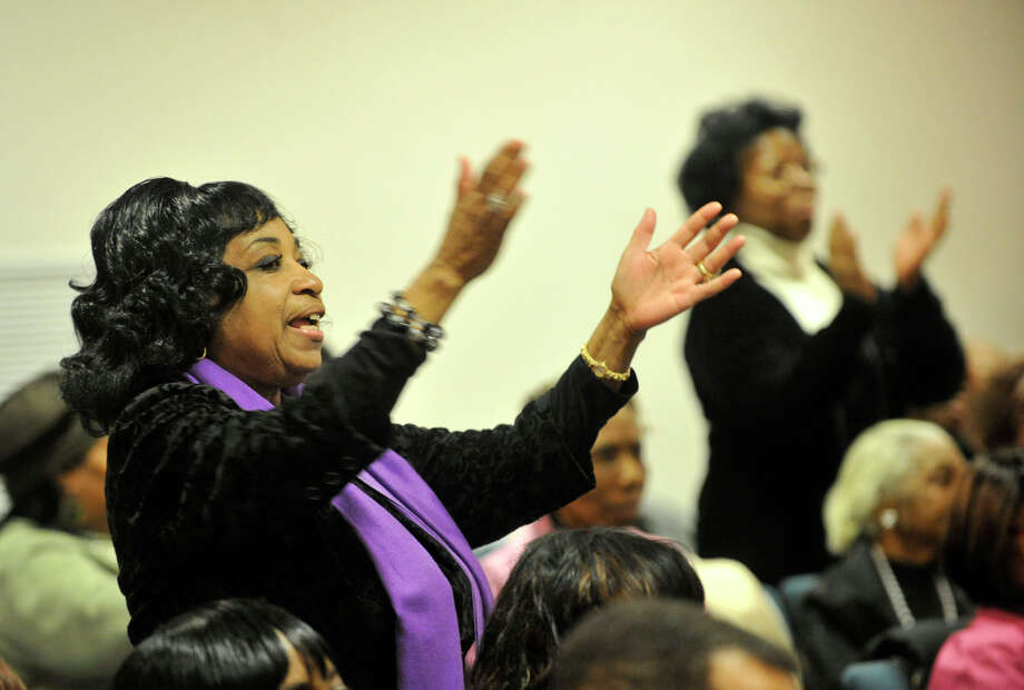 Stamford Board of Representative's Annie Summerville stands to clap during the Dr. Martin Luther King Jr Birthday Commemoration at Faith Tabernacle Missionary Baptist Church in Stamford, Conn., on Sunday, Jan. 19, 2014. Photo: Jason Rearick / Stamford Advocate