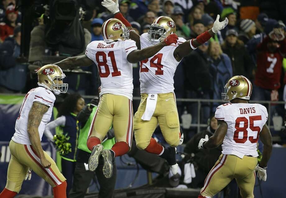 San Francisco 49ers' Anquan Boldin celebrates his touchdown catch with teammate Anthony Dixon (24) during the second half of the NFL football NFC Championship game against the Seattle Seahawks, Sunday, Jan. 19, 2014, in Seattle. (AP Photo/Ted S. Warren) Photo: Ted S. Warren, Associated Press