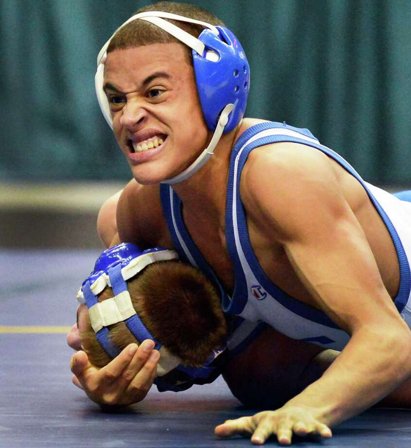 Luis Weierbach, top, of Hoosick Falls, on his way to defeating Danny Fox of Dolgeville in the 106 lb. final at the state wrestling tournament at the Times Union Center in Albany Saturday Feb. 23, 2013.  (John Carl D'Annibale / Times Union) Photo: John Carl D'Annibale / 00021229A
