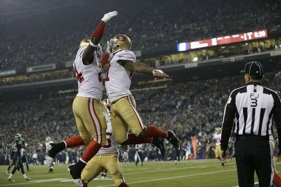 San Francisco 49ers' Anquan Boldin celebrates his touchdown catch with teammate Anthony Dixon (24) during the second half of the NFL football NFC Championship game against the Seattle Seahawks, Sunday, Jan. 19, 2014, in Seattle. (AP Photo/Marcio Jose Sanchez) Photo: Marcio Jose Sanchez, Associated Press