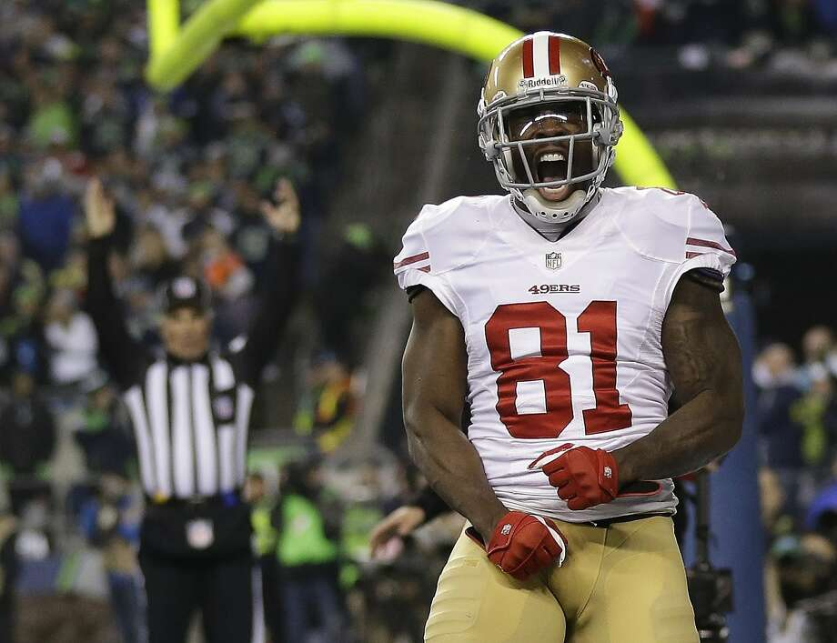 San Francisco 49ers' Anquan Boldin celebrates his touchdown catch during the second half of the NFL football NFC Championship game against the Seattle Seahawks Sunday, Jan. 19, 2014, in Seattle. (AP Photo/Marcio Jose Sanchez) Photo: Marcio Jose Sanchez, Associated Press