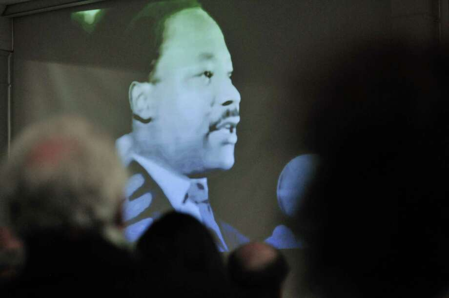 People watch a short speech by Martin Luther King, Jr. that he gave the day before he died at a Martin Luther King, Jr. celebration at the First United Methodist Church on Sunday, Jan. 19, 2014 in Schenectady, NY.  The event was put on by the Martin Luther King, Jr. Coalition of the Schenectady County Human Rights Commission.   (Paul Buckowski / Times Union) Photo: Paul Buckowski / 00025425A
