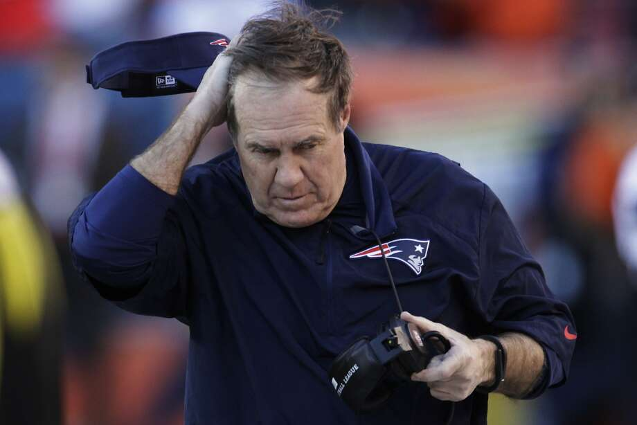 "In 2007, Bill Belichick and the New England Patriots were busted for ""Spy-gate"". The Patriots had been secretly videotaping the defensive signals of the New York Jets and were caught. Belichick was fined $500,000 and the team lost a first-round draft pick. (AP Photo/Joe Mahoney) Photo: Joe Mahoney, Associated Press"