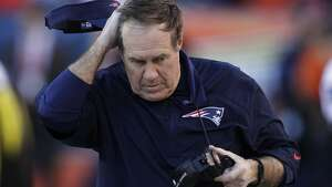 New England Patriots head coach Bill Belichick rubs his head in the closing minutes of the second half of the AFC Championship NFL playoff football game in Denver, Sunday, Jan. 19, 2014. The Broncos defeated the Patriots 26-16 to advance to the Super Bowl. (AP Photo/Joe Mahoney)