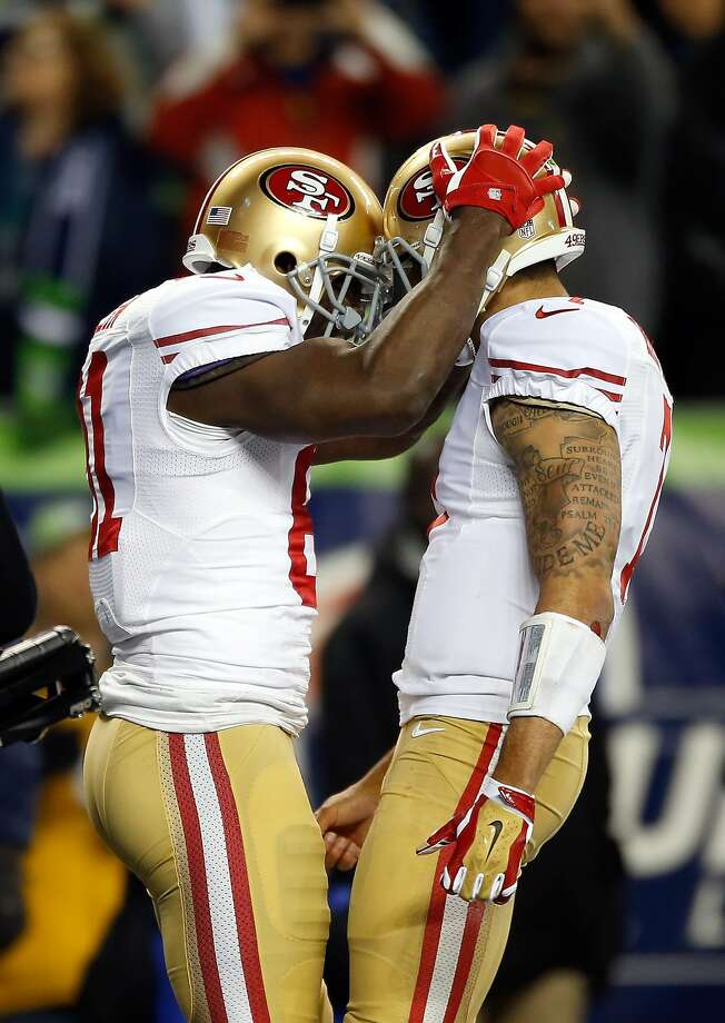 SEATTLE, WA - JANUARY 19:  (L-R) Wide receiver Anquan Boldin #81 of the San Francisco 49ers celebrates with quarterback Colin Kaepernick #7 after Boldin makes a 26-yard touchdown catch against the Seattle Seahawks in the third quarter during the 2014 NFC Championship at CenturyLink Field on January 19, 2014 in Seattle, Washington.  (Photo by Otto Greule Jr/Getty Images) Photo: Otto Greule Jr, Getty Images