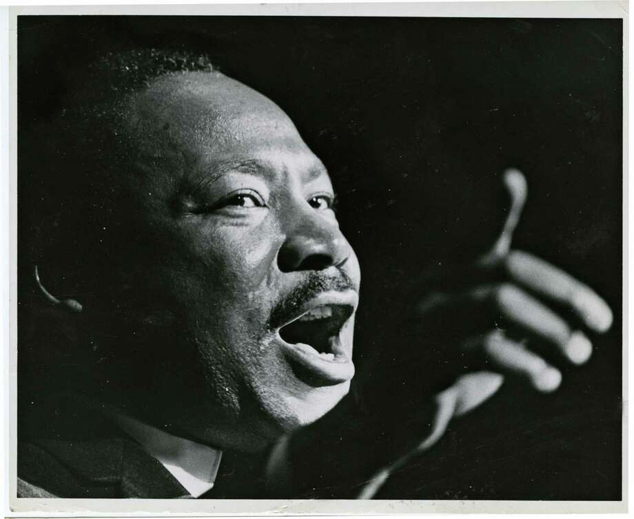 Despite a smoke bomb, Martin Luther King Jr. continued his speech at the Sam Houston Coliseum in October 1967, just six months before his slaying. Photo: Blair Pittman, HC Staff / Houston Chronicle