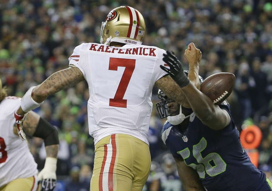 Cliff Avril of the Seahawks forces a fumble against 49ers quarterback Colin Kaepernick Photo: Matt Slocum, Associated Press