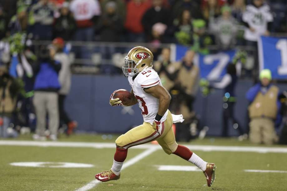 LaMichael James of the 49ers returns a kickoff against the Seahawks. Photo: Elaine Thompson, Associated Press