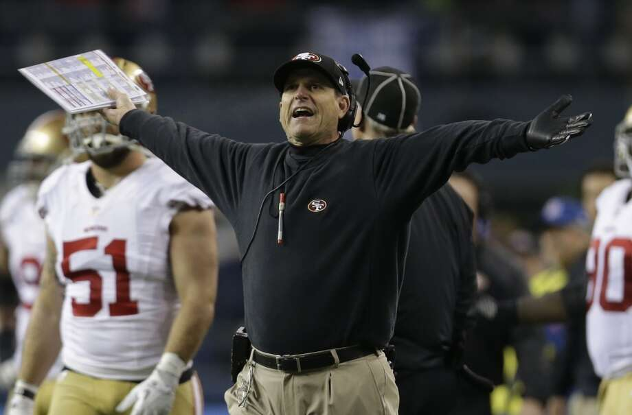 49ers coach Jim Harbaugh reacts to a call during the NFC Championship game against the Seahawks. Photo: Marcio Jose Sanchez, Associated Press
