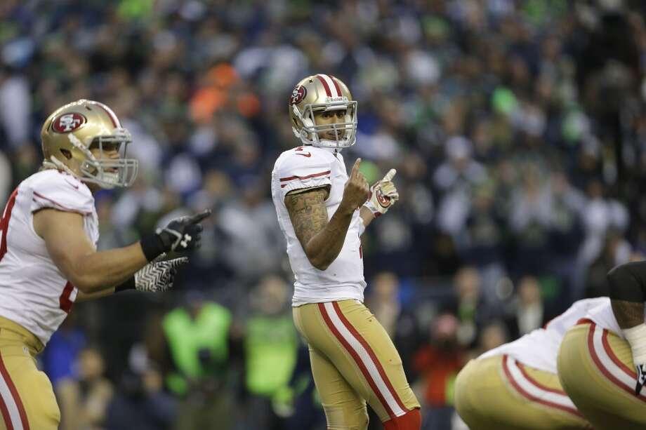 49ers quarterback Colin Kaepernick calls signals before taking a snap against the Seahawks. Photo: Marcio Jose Sanchez, Associated Press