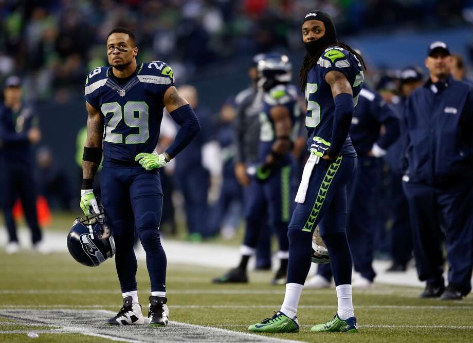Seahawks defensive backs Earl Thomas and Richard Sherman watch the action against the 49ers in the NFC Championship game. Photo: Otto Greule Jr., Getty Images