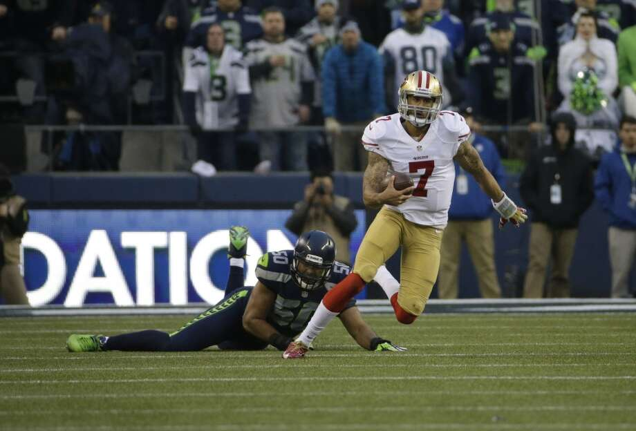 49ers quarterback Colin Kaepernick scrambles against the Seahawks. Photo: Matt Slocum, Associated Press
