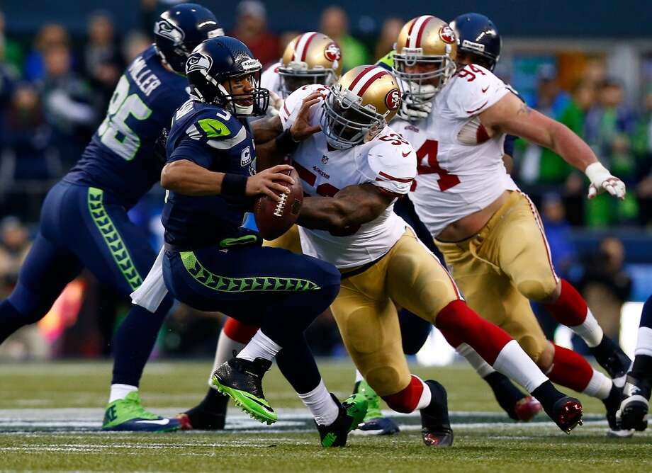 49ers linebacker NaVorro Bowman records a sack on Seahawks quarterback Russell Wilson. Photo: Tom Pennington, Getty Images