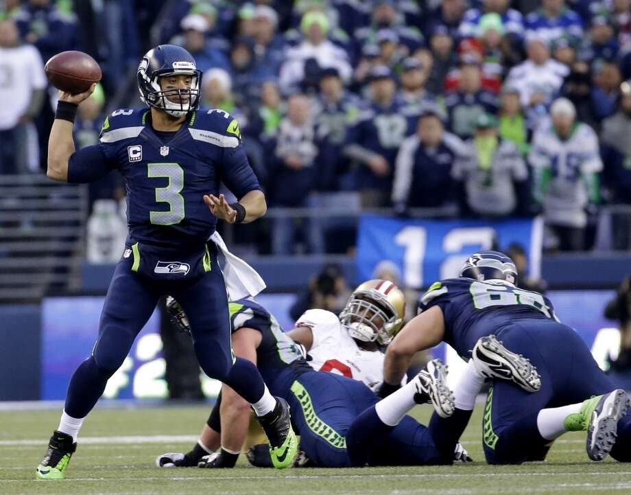 Seahawks quarterback Russell Wilson throws a pass against the 49ers. Photo: Ted S. Warren, Associated Press