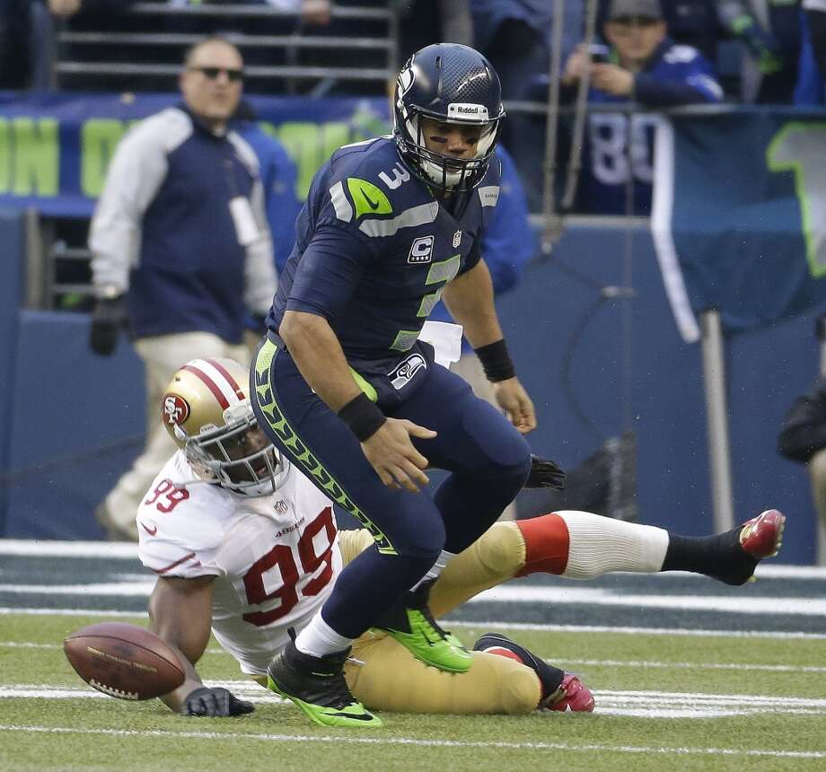 Aldon Smith of the 49ers forces a fumble against Seahawks quarterback Russell Wilson Photo: Ted S. Warren, Associated Press