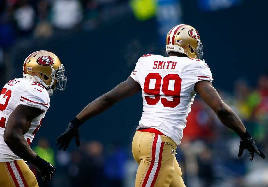 Aldon Smith of the 49ers reacts after forcing a fumble against the Seahawks. Photo: Jonathan Ferrey, Getty Images