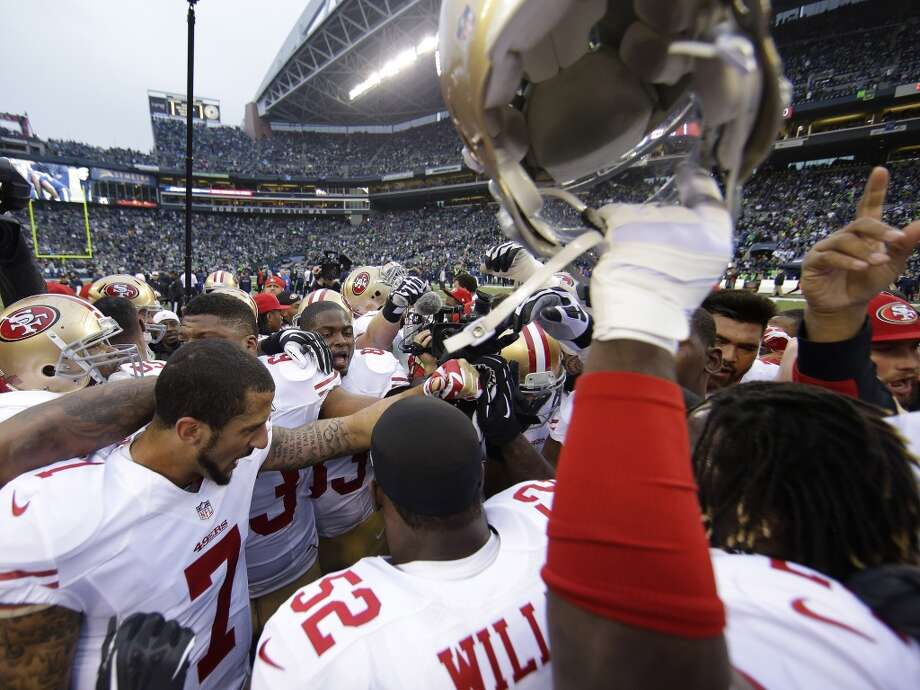 49ers players huddle up before facing the Seahawks in the NFC Championship game. Photo: Matt Slocum, Associated Press