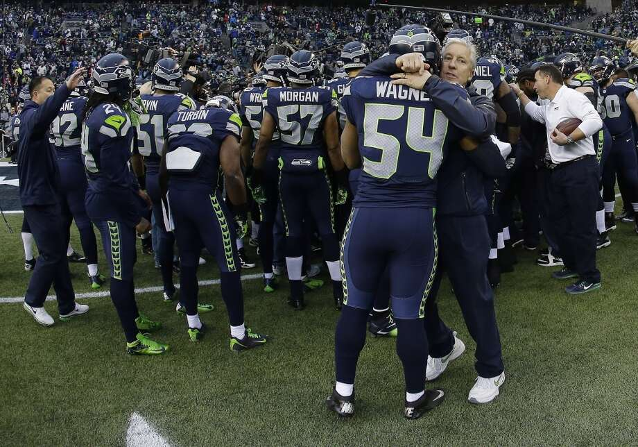Seahawks players huddle up before facing the 49ers in the NFC Championship game. Photo: Matt Slocum, Associated Press