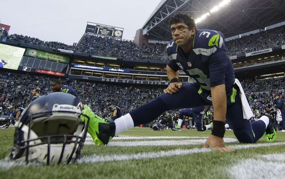 Seahawks quarterback Russell Wilson warms up before facing the 49ers in the NFC Championship game. Photo: Matt Slocum, Associated Press