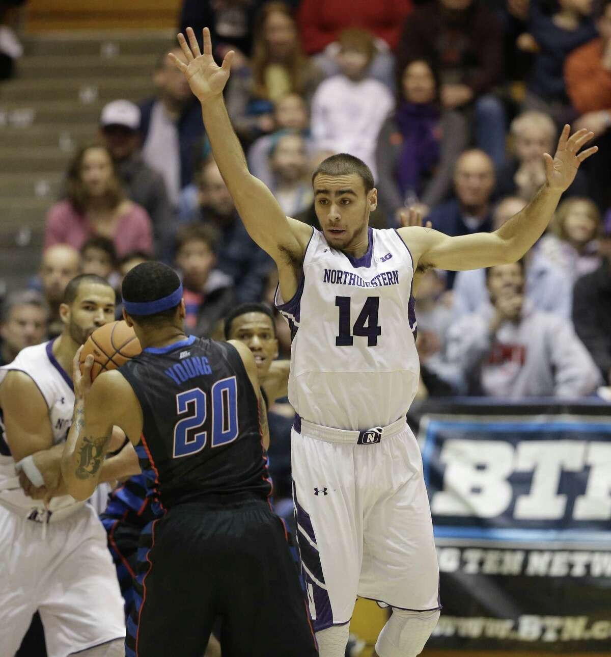 Tre Demps (right), who went to Reagan, has been a consistent bench scorer for Northwestern.