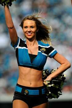 JACKSONVILLE, FL - DECEMBER 13:  A Jacksonville Jaguar cheerleader performs during the game against the Miami Dolphins at Jacksonville Municipal Stadium on December 13, 2009 in Jacksonville, Florida.  (Photo by Sam Greenwood/Getty Images) Photo: Sam Greenwood, Getty Images / 2009 Getty Images