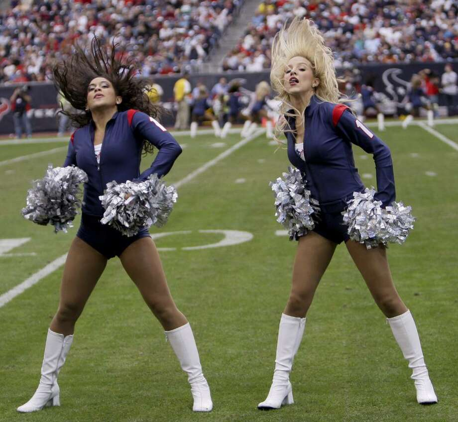 HOUSTON - DECEMBER 13:  Houston Texans cheerleaders perform during the game against the Seattle Seahawks at Reliant Stadium on December 13, 2009 in Houston, Texas.  (Photo by Bob Levey/Getty Images) Photo: Bob Levey, Getty Images / 2009 Getty Images