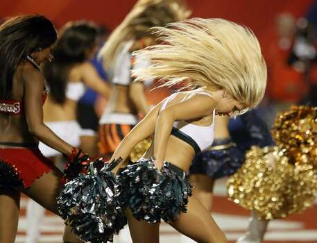 MIAMI GARDENS, FL - JANUARY 31:  A Philadelphia Eagles cheerleader performs her routine during the 2010 AFC-NFC Pro Bowl game at Sun Life Stadium on January 31, 2010 in Miami Gardens, Florida. The AFC defeated the NFC 41-34. (Photo by Scott Halleran/Getty Images) Photo: Scott Halleran, Getty Images / 2010 Getty Images