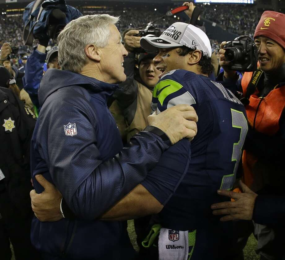 Seahawks head coach Pete Carroll celebrates with Russell Wilson. Photo: Matt Slocum, Associated Press