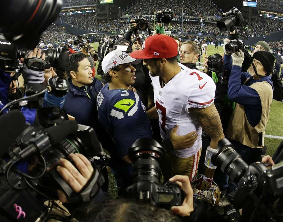 Russell Wilson, left, talks to San Colin Kaepernick. Photo: Matt Slocum, Associated Press