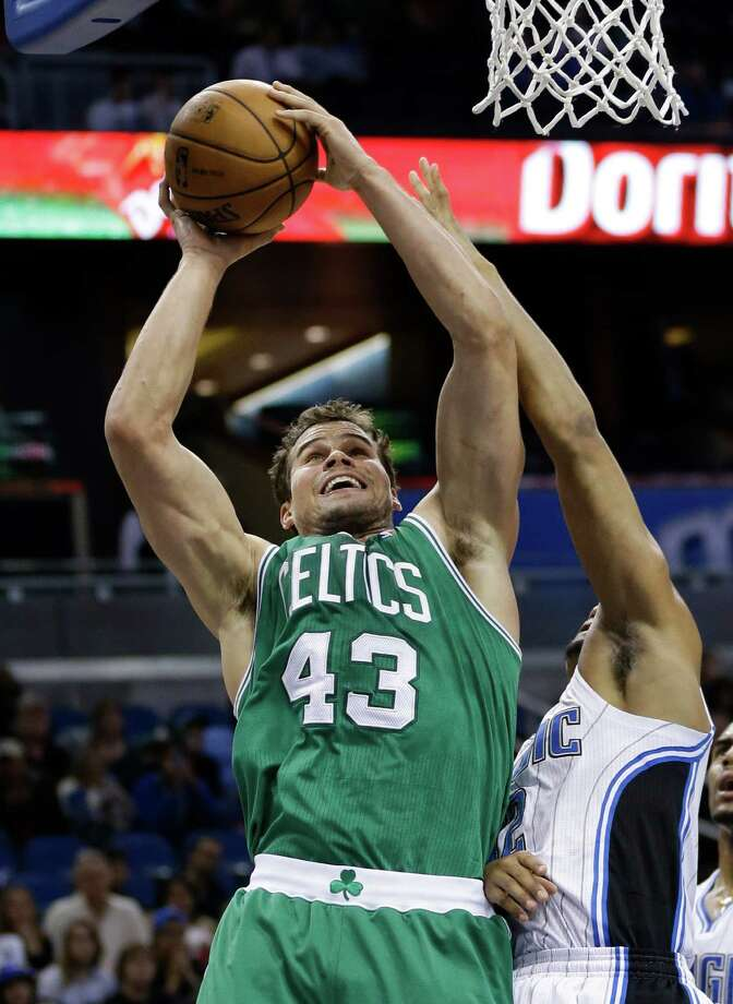 Boston Celtics' Kris Humphries (43) takes a shot despite the defensive effort by Orlando Magic's Tobias Harris, right, during the first half of an NBA basketball game in Orlando, Fla., Sunday, Jan. 19, 2014. (AP Photo/John Raoux) ORG XMIT: DOA104 Photo: John Raoux / AP