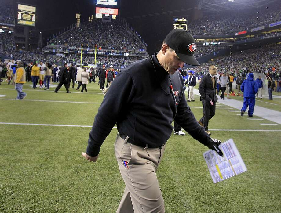 Coach Jim Harbaugh walks off the field after the 49ers' NFC Championship Game loss in Seattle. Photo: Brant Ward, The Chronicle