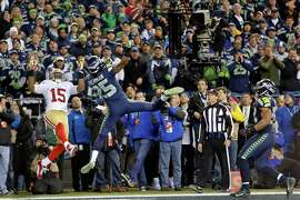 Michael Crabtree never came close to Colin Kaepernick's underthrown pass after Seattle's Richard Sherman tipped the ball away to preserve a 23-17 win.