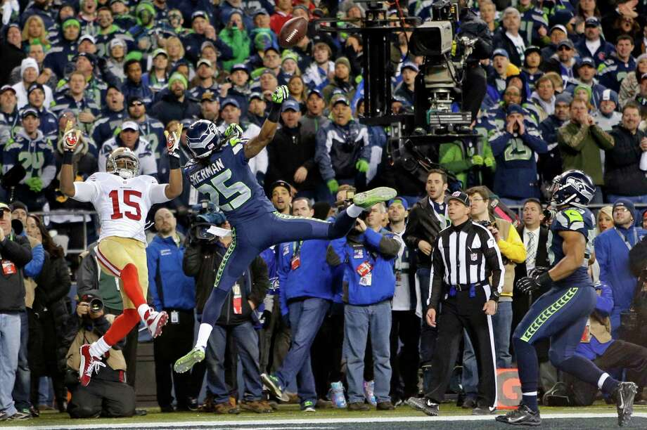 A pass thrown by quarterback Colin Kaepernick, which was intended for 49ers Michael Crabtree, (15) was  tipped by Seattle's Richard Sherman, (25) and intercepted by Malcolm Smith, (53) to stop the final drive by the  San Francisco 49ers who went on to lose to the Seattle Seahawks 23-17 in the NFC Championship game at CenturyLink Field in Seattle, Washington on Sunday Jan. 19,  2014. Photo: Michael Macor / The Chronicle / ONLINE_YES