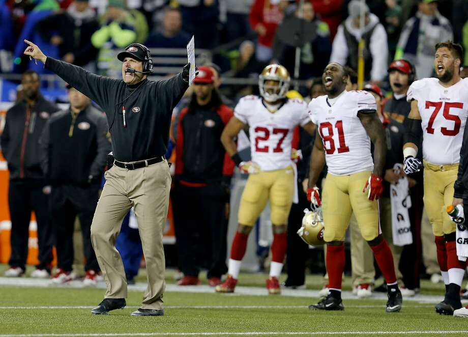 49ers coach Jim Harbaugh and the bench reacted to a questionable call in the second half Sunday January 19, 2014. The Seattle Seahawks defeated the San Francisco 49ers 23-17 to win the NFC championship and a trip to the Super Bowl at CenturyLink Field in Seattle, Washington. Photo: Brant Ward, The Chronicle