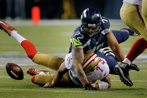 Kaepernick's arm has yet to bother Seahawks - Photo