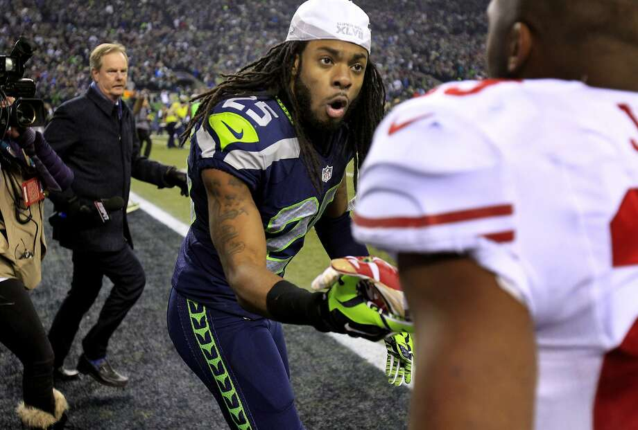Richard Sherman (25) of the Seahawks greeted LaMichael James, who was injured earlier in the game. The Seattle Seahawks defeated the San Francisco 49ers 23-17 to win the NFC championship and a trip to the Super Bowl at CenturyLink Field in Seattle, Washington. Photo: Brant Ward, The Chronicle
