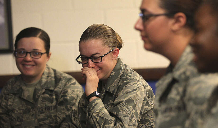 Haley Moore (center), 18, of Layton, Utah, and other Air Force recruits talk about their encounter with bats in their dorm. Photo: Jerry Lara / San Antonio Express-News / ©2013 San Antonio Express-News