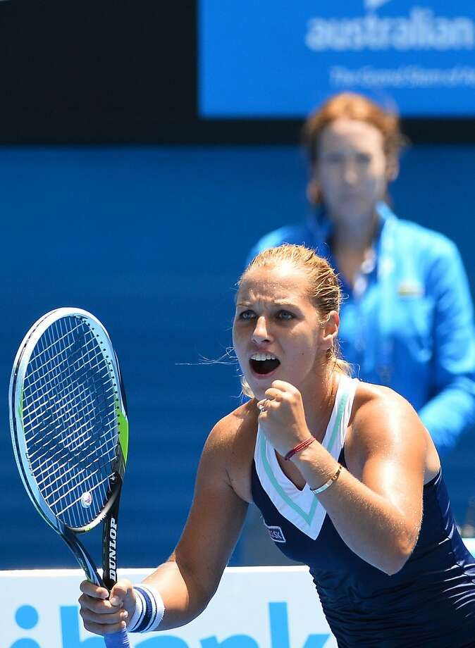 Slovakia's Dominika Cibulkova celebrates her 3-6, 6-4, 6-1 defeat of No. 3 seed Maria Sharapova at the Australian Open. Photo: Saeed Khan, AFP/Getty Images