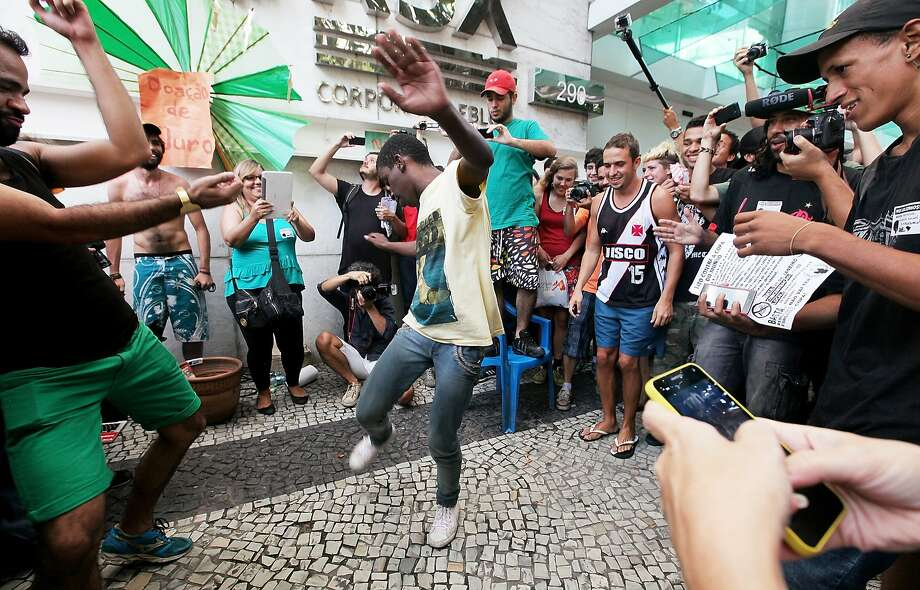 RIO DE JANEIRO, BRAZIL - JANUARY 19:  A young man dances during a 'rolezinho' in front of the Leblon Shopping mall on January 19, 2014 in Rio de Janeiro, Brazil. Rolezinhos are a new form of social gathering and protest organized and joined primarily by working class teens in Brazil at shopping malls, traditionally the stomping grounds of the upper and middle classes. The controversial mass gatherings have shone a spotlight on class divisions in the country and led to some arrests and violence although most have been peaceful. The mall decided to close for business in anticipation of the event.  (Photo by Mario Tama/Getty Images) ***BESTPIX*** Photo: Mario Tama, Getty Images