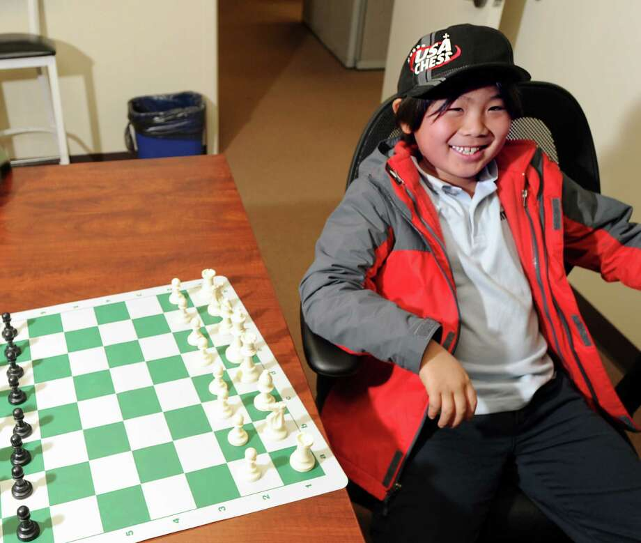 Chess prodigy Max Lu, 8, of Greenwich, at the Greenwich Time office on Jan. 16. Photo: Bob Luckey / Greenwich Time