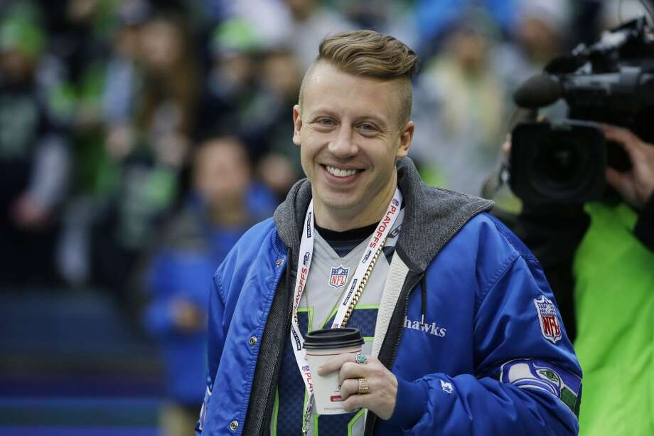 Rapper Macklemore watches teams warm up before the NFL football NFC Championship game between the Seattle Seahawks and the San Francisco 49ers, Sunday, Jan. 19, 2014, in Seattle. (AP Photo/Ted S. Warren) Photo: AP